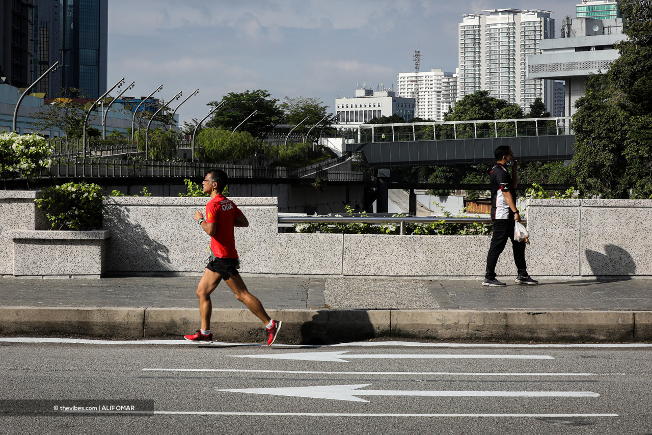 A man jogs in the quiet, almost carless streets of Kuala Lumpur. – ALIF OMAR/The Vibes pic, June 1, 2021