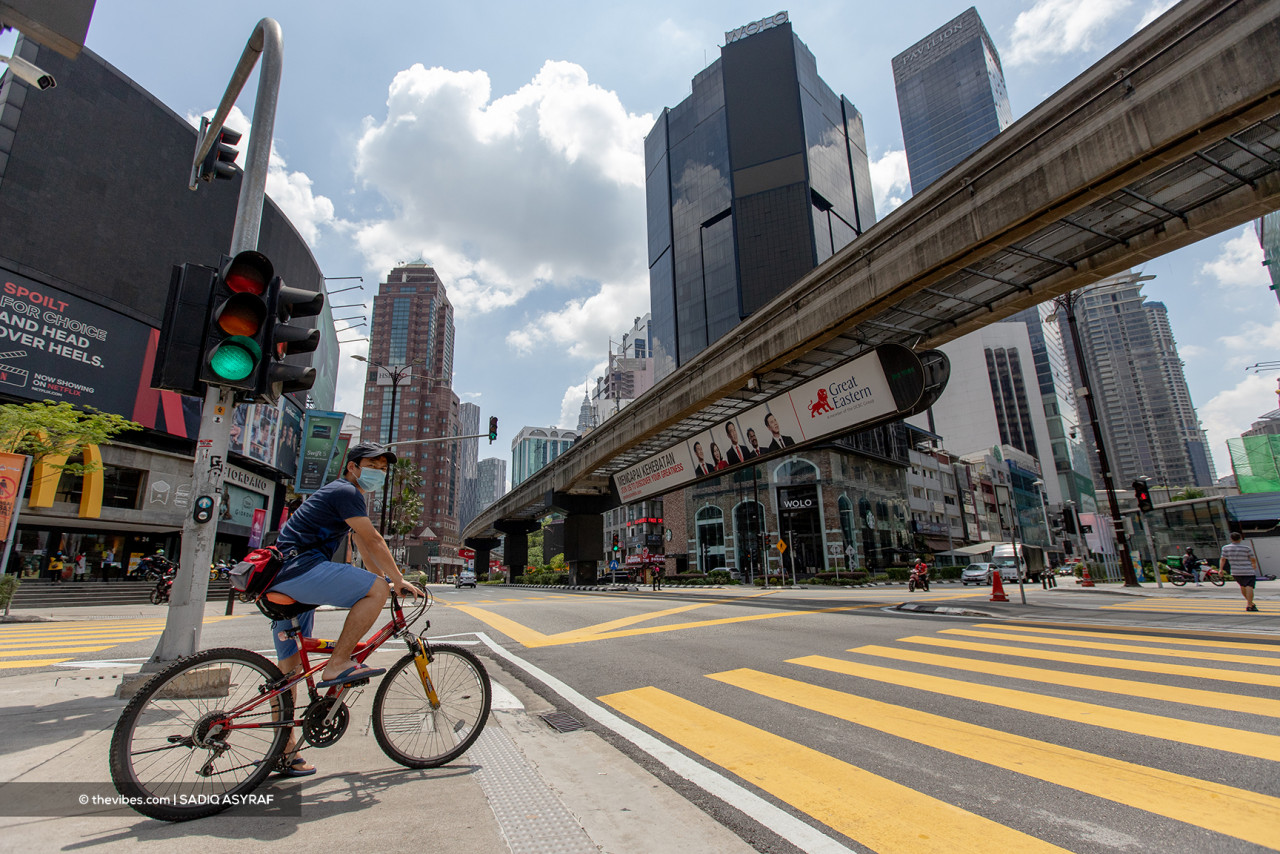It is a good day for cyclists in Kuala Lumpur, whose roads are left largely empty due to the lockdown. – SADIQ ASYRAF/The Vibes pic, June 1, 2021