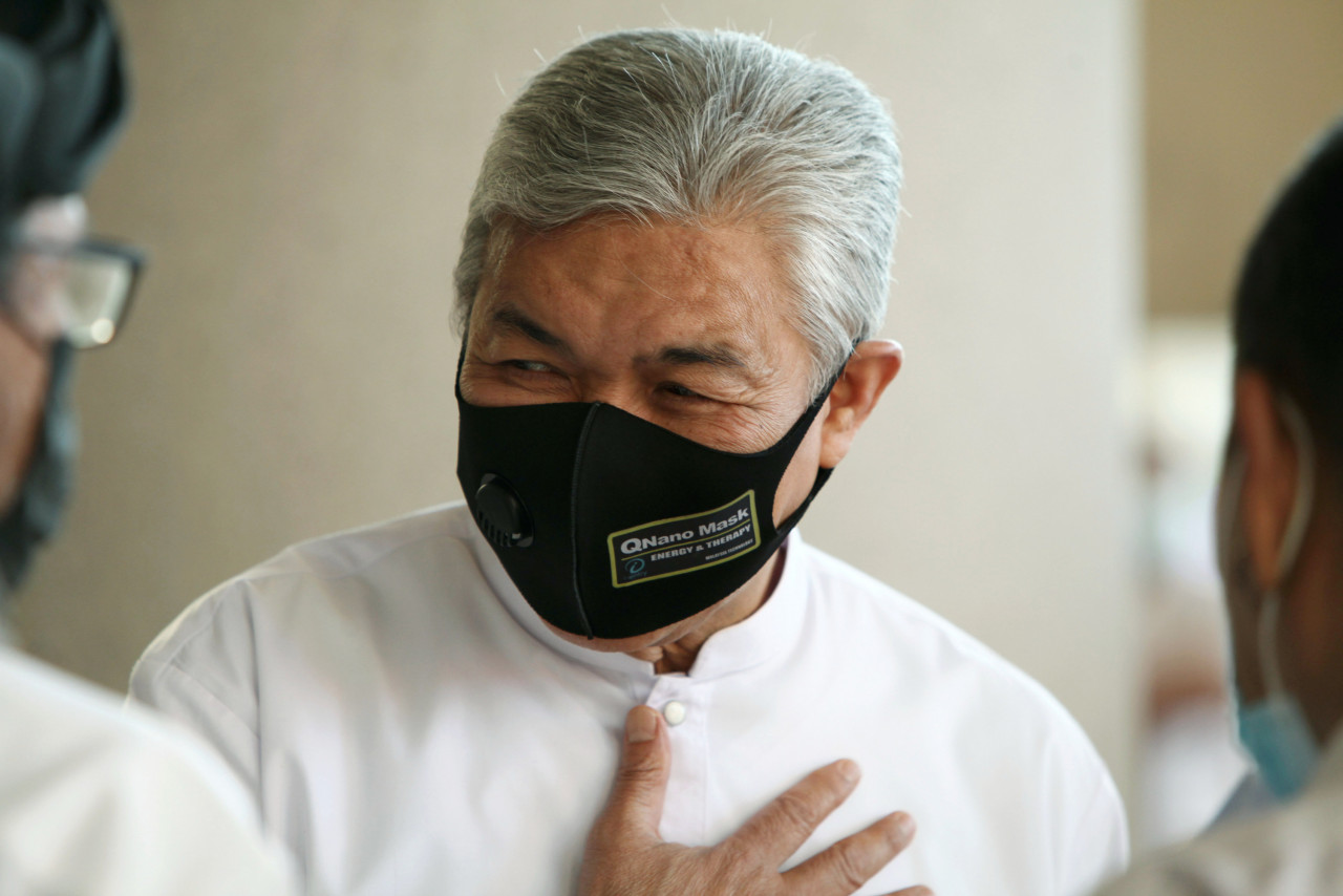 Umno president Datuk Seri Ahmad Zahid Hamidi has been playing cloak and dagger to ensure he remains a free man, as he, too, faces a raft of graft charges, says an observer. – Bernama pic, July 7, 2021