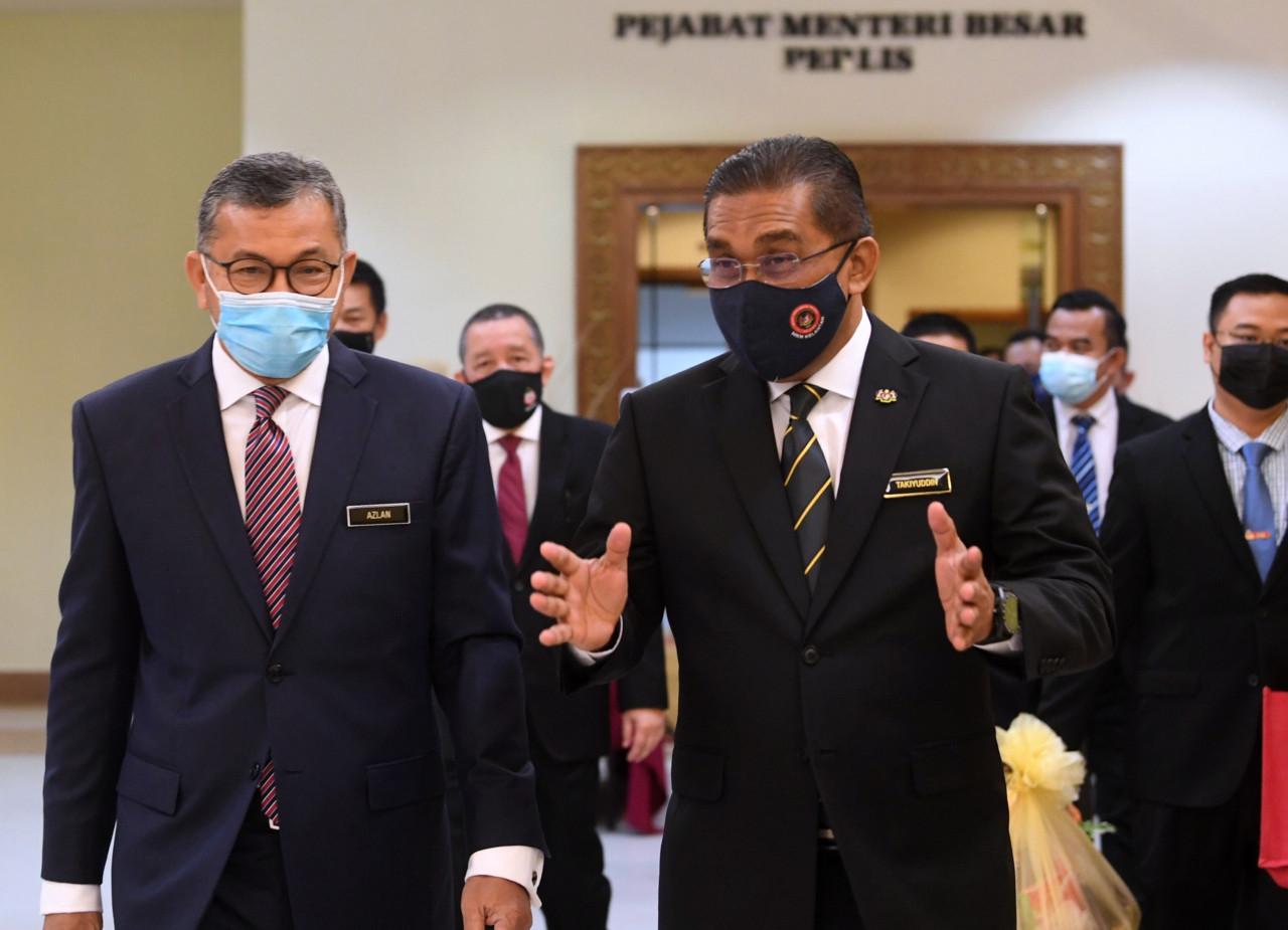 The king has named Law Minister Datuk Seri Takiyuddin Hassan (right) as having let him down for his performance in the Dewan Rakyat this week. – Bernama pic, July 30, 2021